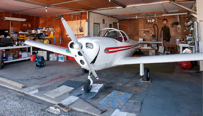 old airplane sitting in a garage