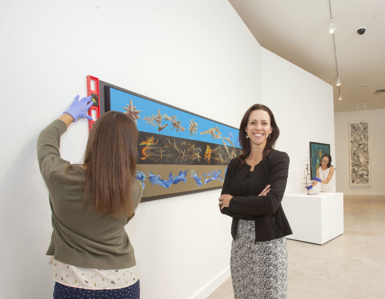 Image of NEHMA director Katie-Lee Koven standing in a gallery.