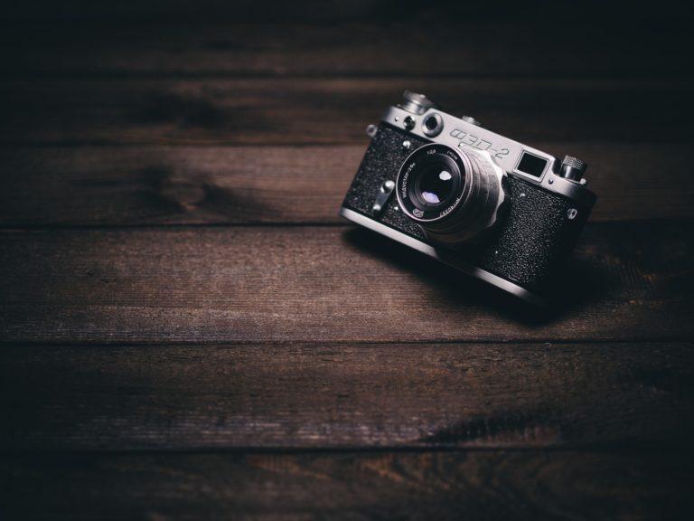 camera sitting on a wood desk