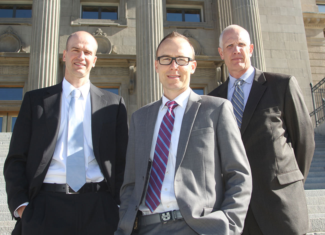 three fbi agents standing on the steps to the Idaho State Capitol Building