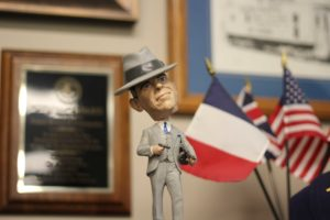 A bobblehead of the famous gangster John Dilinger