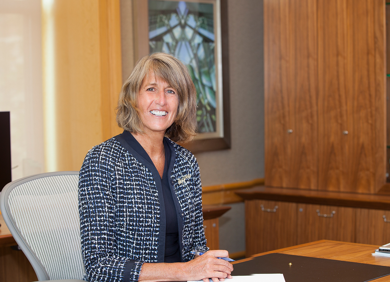 President Noelle Cockett seated at her desk