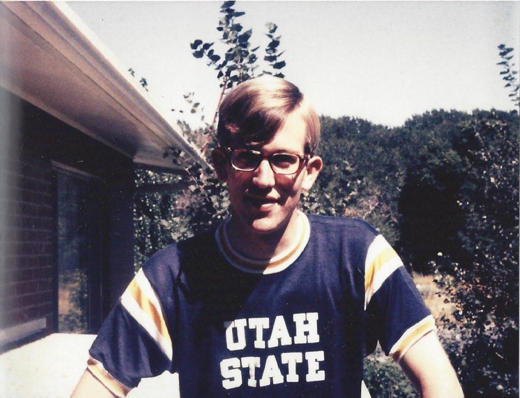 Man wearing a Utah State T-shirt.