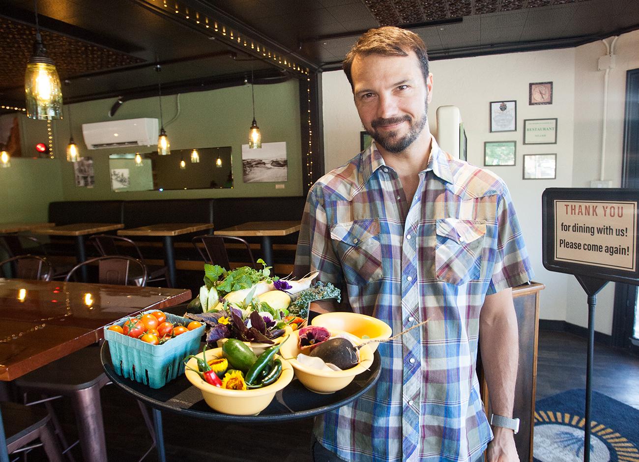 Chef Alex Borichevsky stands in his restaurant