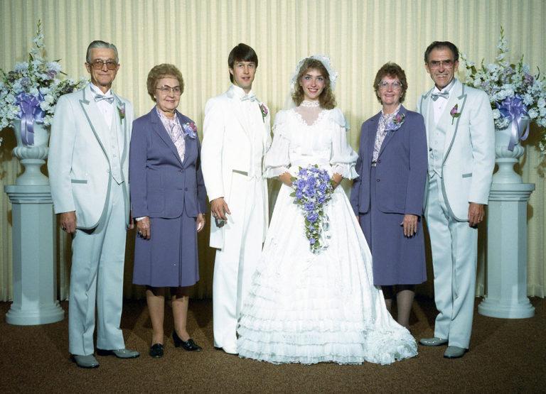 family in wedding attire