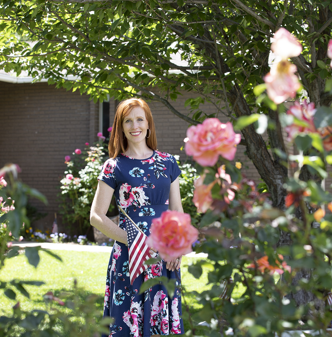Jennie Taylor with roses her husband planted.
