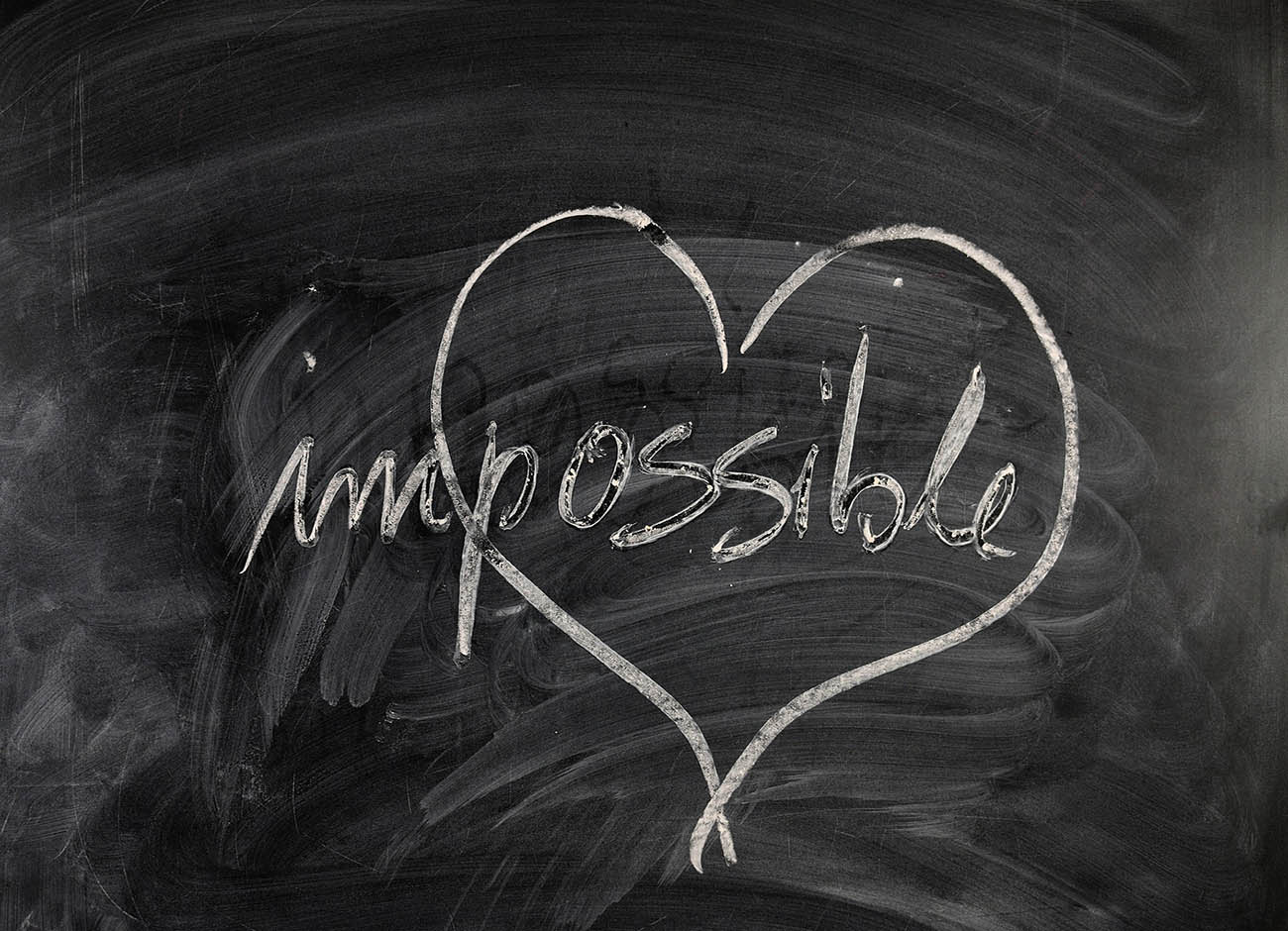 "chalkboard with heart on it surrounding the word ""possible."""