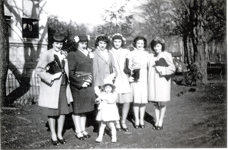 Old family photo showing the author's aunts standing in a line on a lawn.