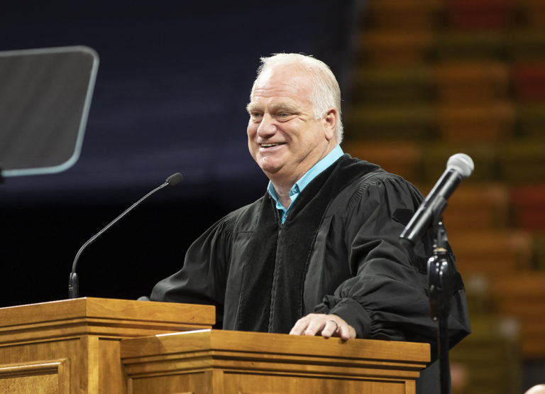 Eric Hipple delivers a talk from the lectern at commencement