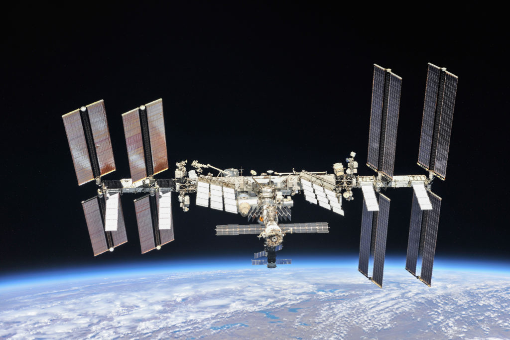 the ISS floats above the earth