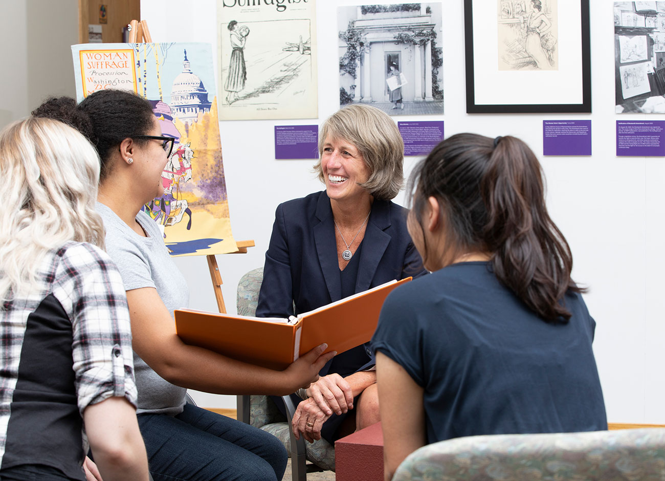 president Noelle Cockett talks with students at the Anthropology Museum.