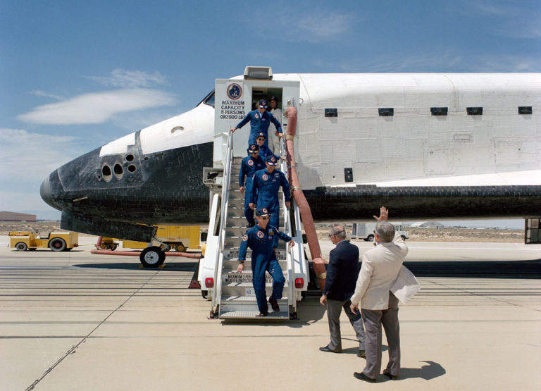 Mary Cleave and her fellow astronauts descend from the space shuttle steps.