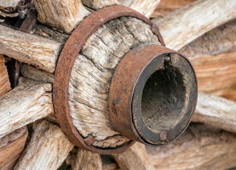 a weathered old wagon wheel