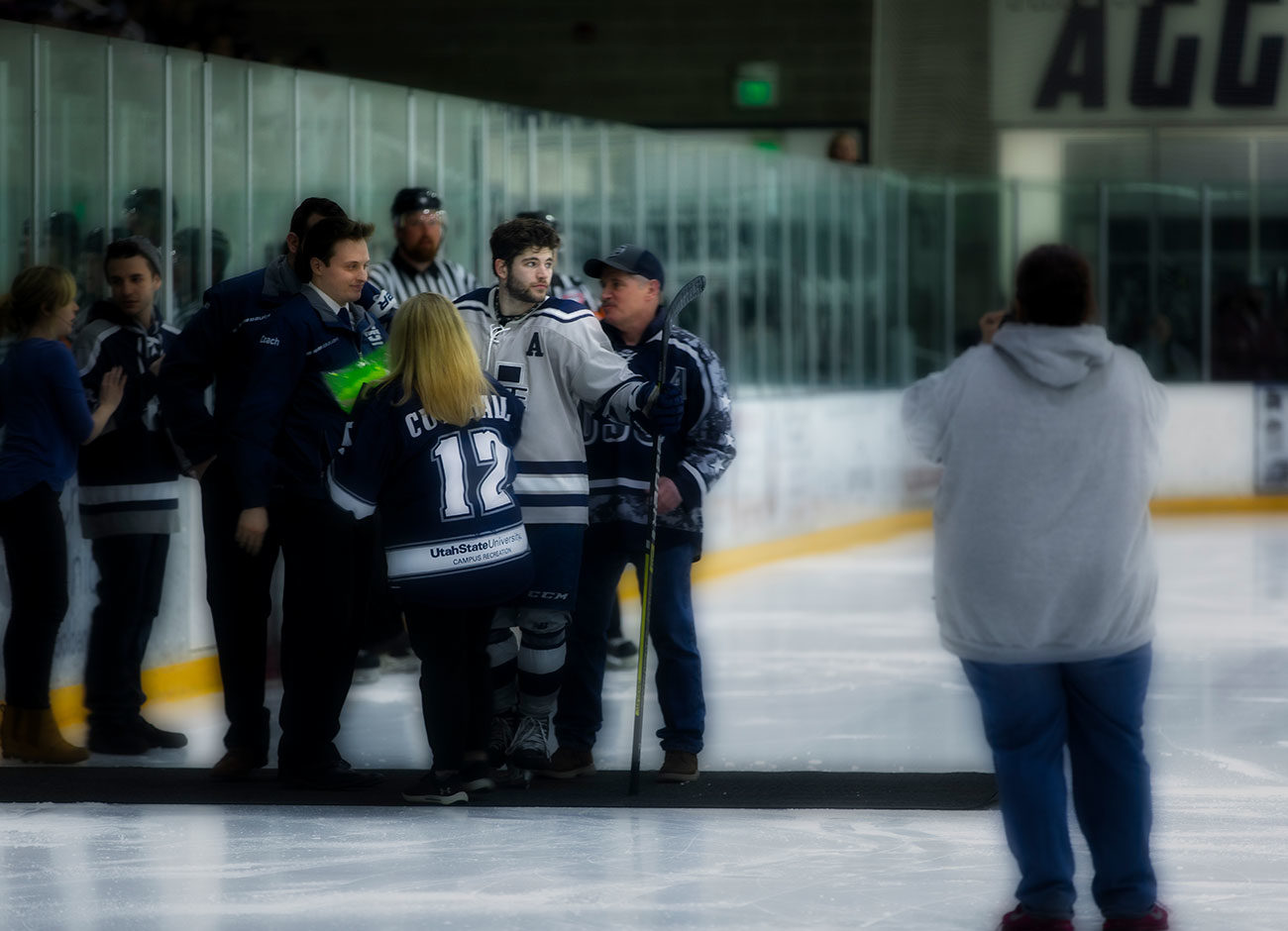 hockey player Chris Cutshall looks wistfully at the ice after his last game.