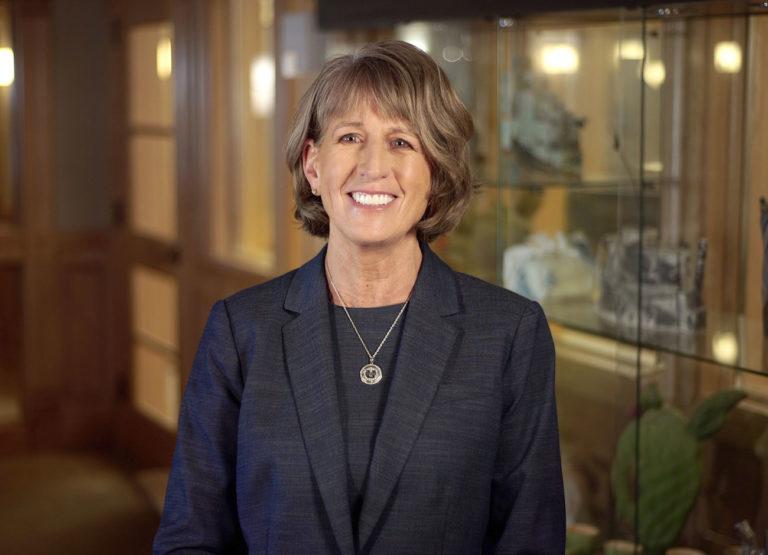 A smiling USU President Noelle Cockett in her office.