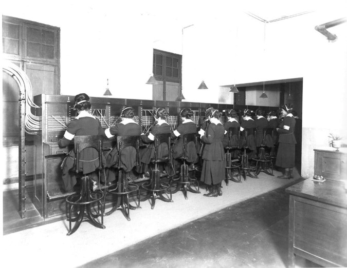 Hello Girls sitting on stools connecting calls during WWI