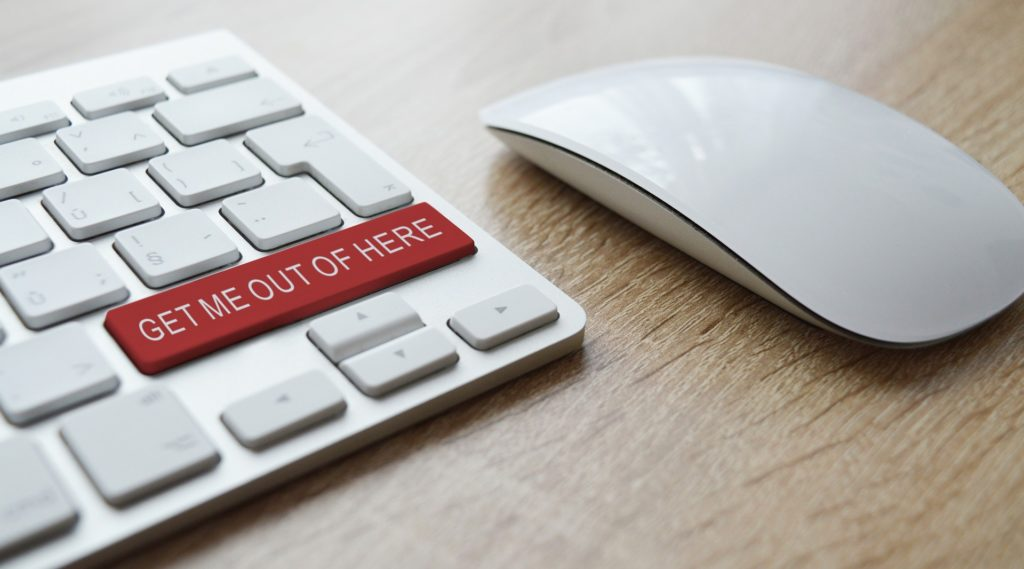 "a computer keyboard with a red ""get me out of here"" key"