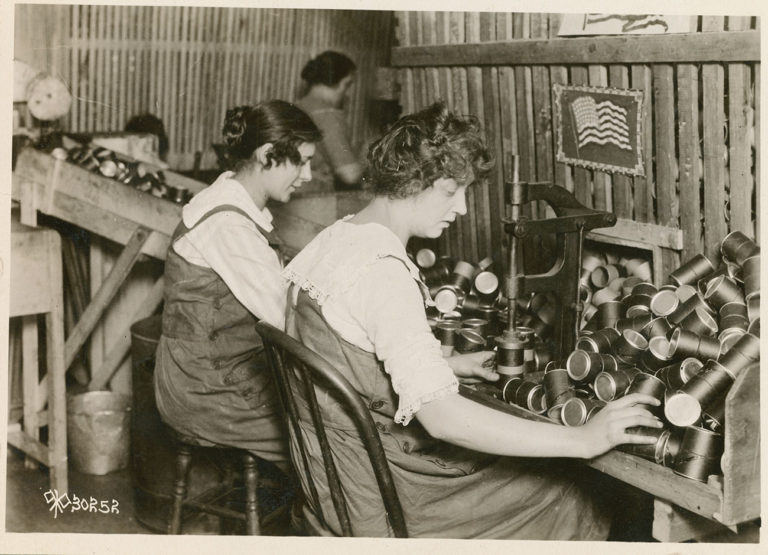 two women assembling mortars during WWI in Hartford, CT.