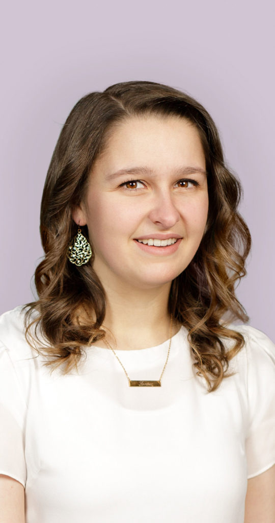 a young woman with brown hair is dressed all in white
