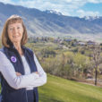 Joyce Kinkead stands on Old Main hill overlooking the snow covered peaks of the valley