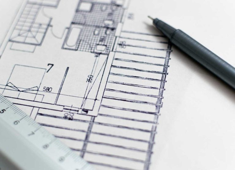 a marker, a ruler, on a architectural rendering