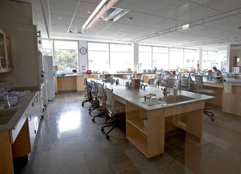 an empty lab with cleared benches and pushed in chairs.
