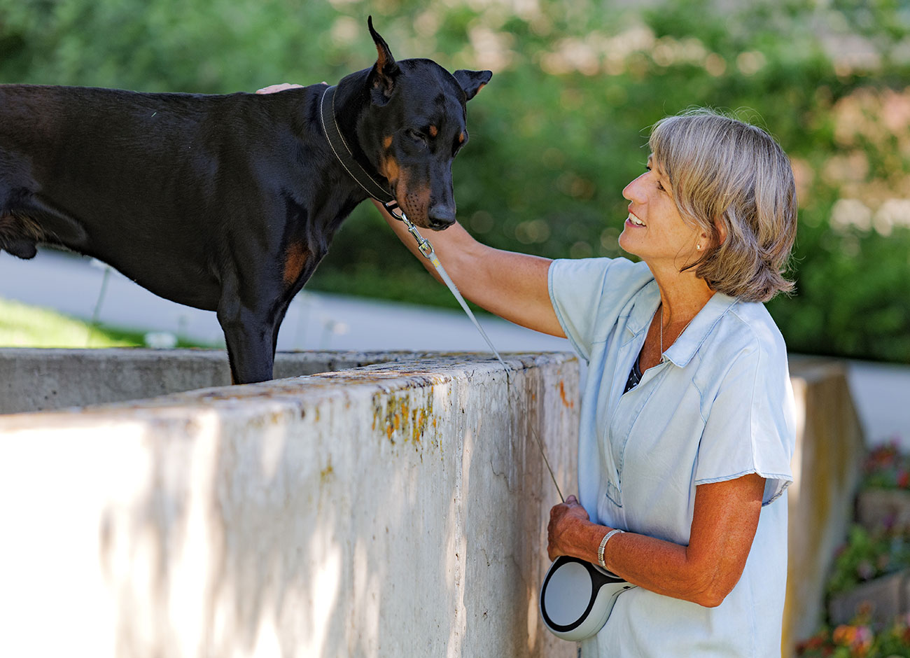 Noelle Cockett looks at her grand dog Duke.