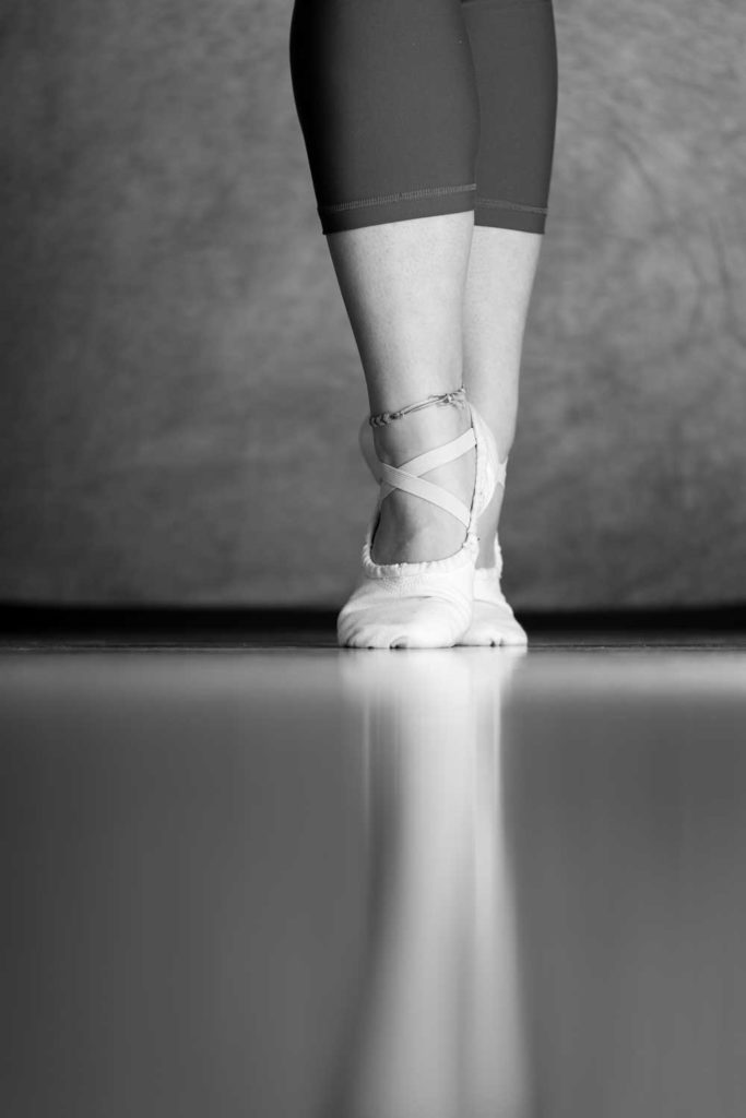 a close up shot of ballerina in cloth shoes
