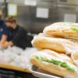 a stack of sandwiches wrapped in plastic wrap