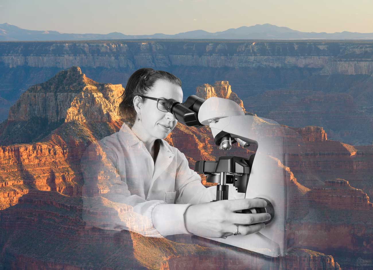 a woman scientist looks through a microscope overlayed with an image of the grand canyon