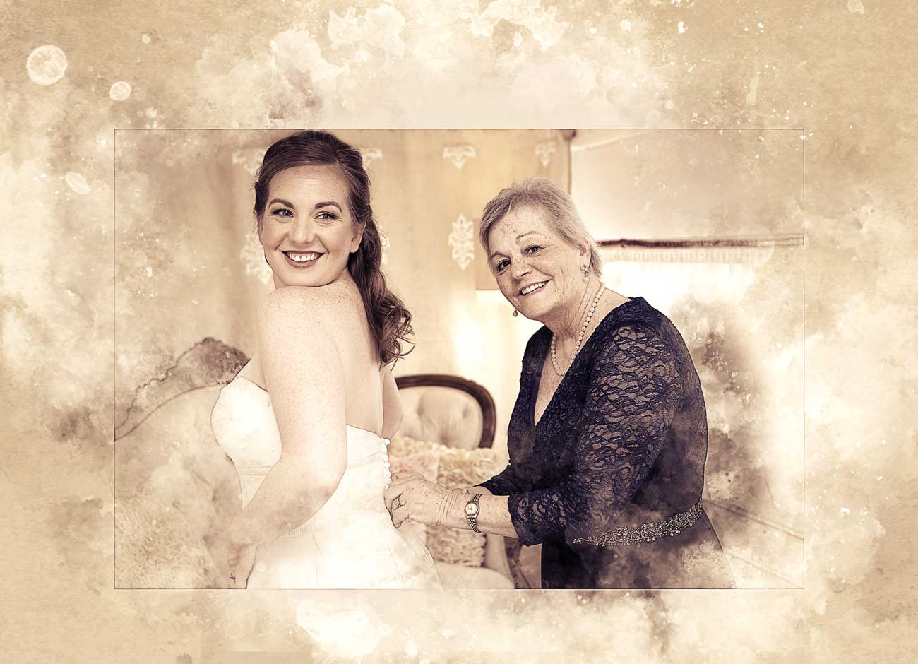 a daughter in a wedding dress poses with her mom who is buttoning the back of her dress