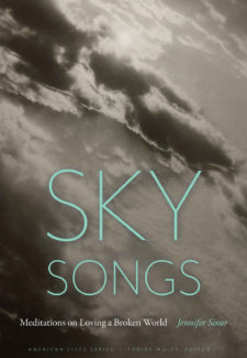a black and white photo of a sun behind clouds with words: Sky Songs - Meditations on Loving a Broken World by Jennifer Sinor