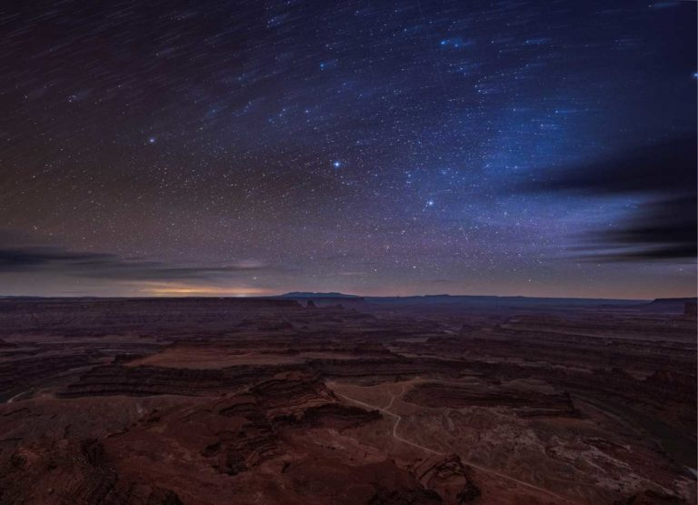 the Milky Way unfolds above a night time desert scene