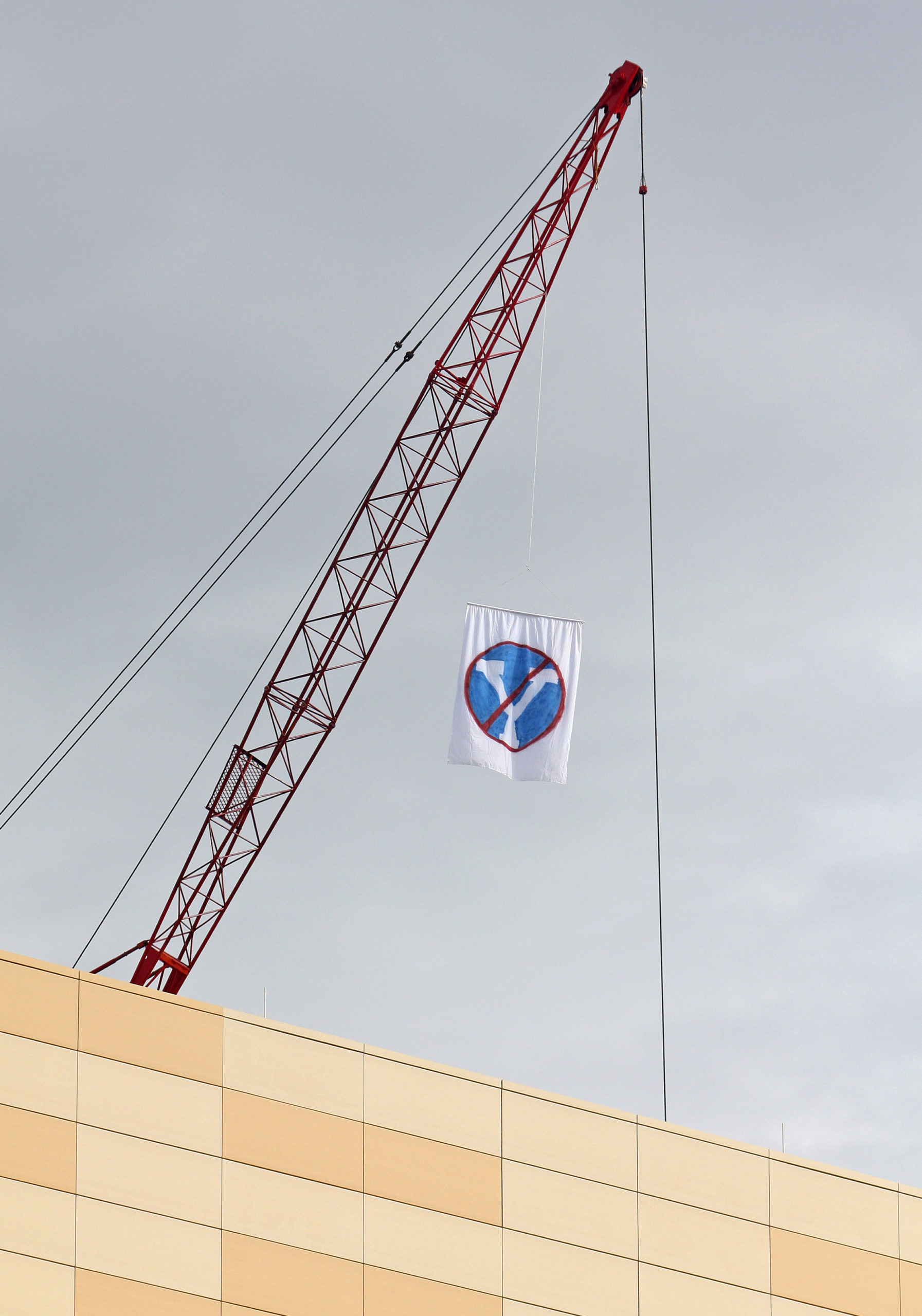 An anti-BYU flag hangs from a crane near the Huntsman School of Business in 2013.