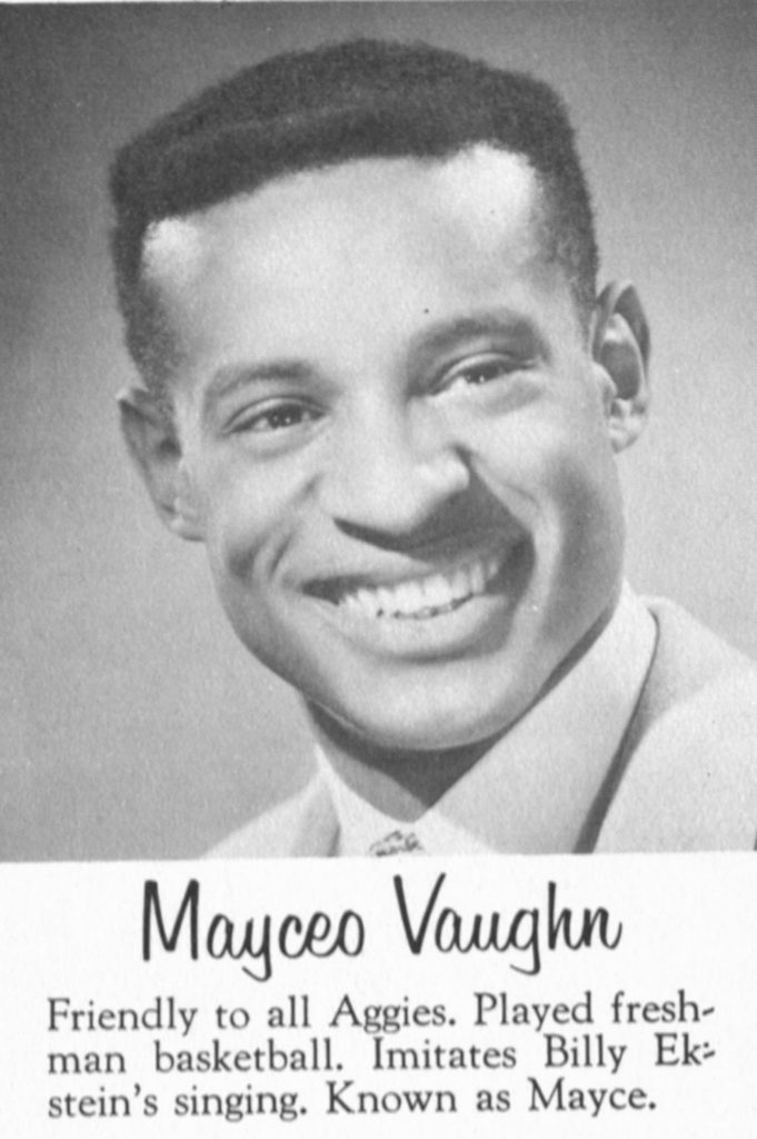 black and white year book headshot of Maceyo Vaughn, a young African American man. He is wearing a broad smile, a tie, crisp white button up and jacket.